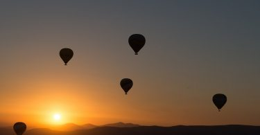 four hot air balloons that have drifted apart