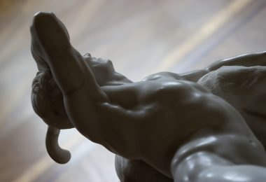 statue of a naked and conquered man