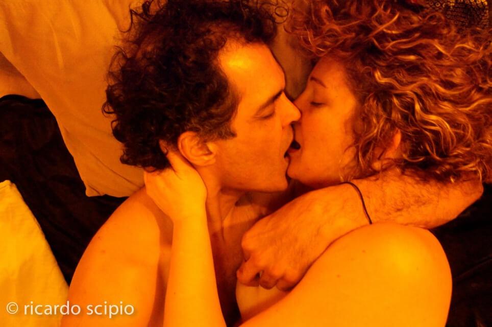 Caucasian man and Caucasian woman kissing