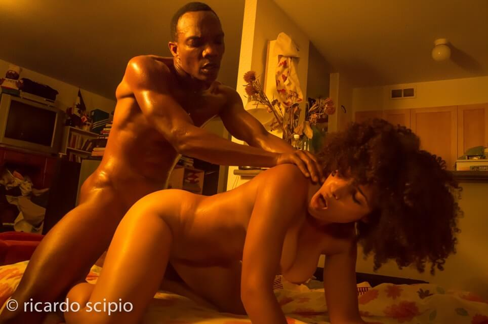 African American man fucking African American woman doggy style