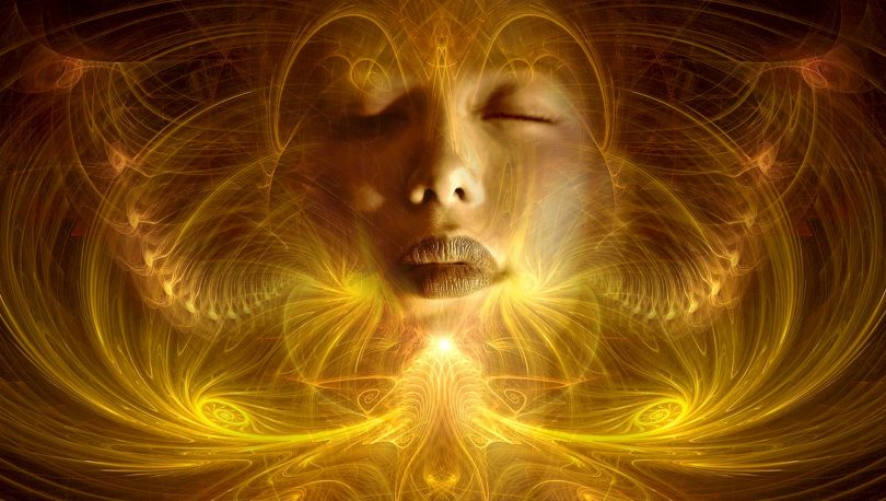 woman surrounded by gold swirls and sensations