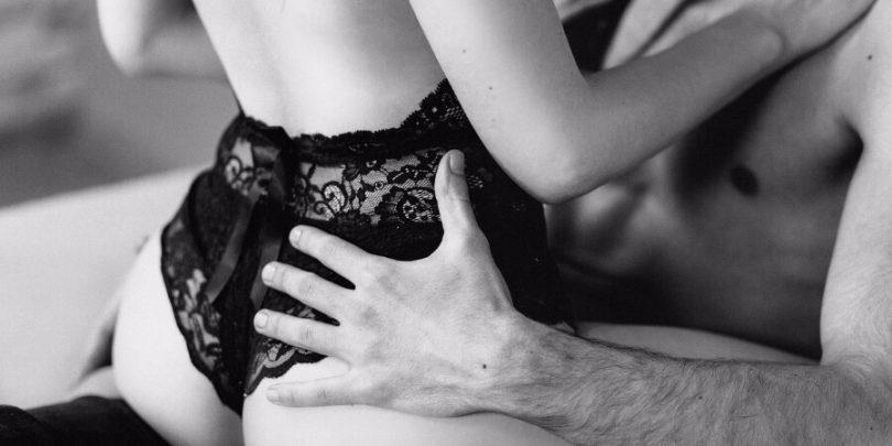 sexy woman on man's lap enjoying each other