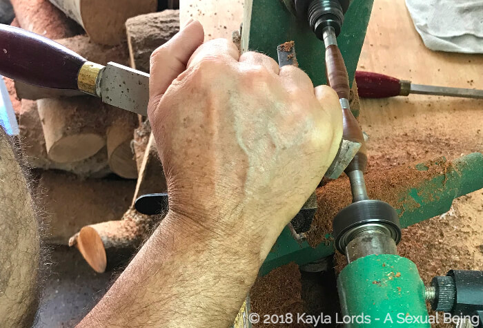 John Brownstone's strong hands holding his tools