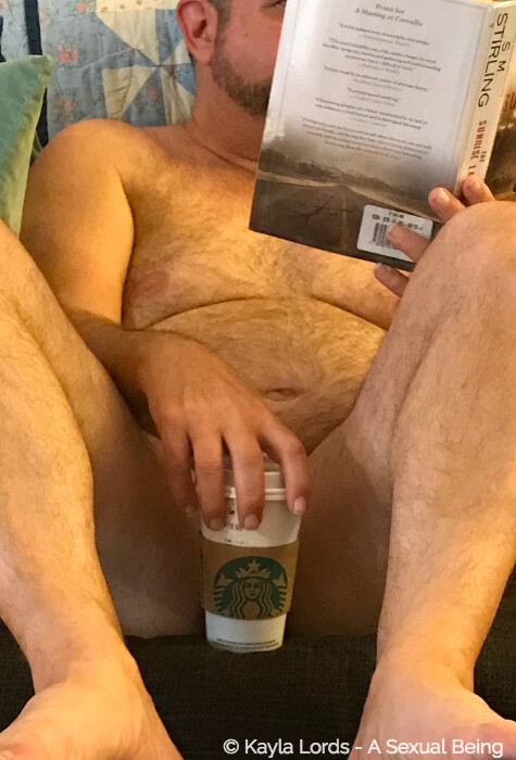 John Brownstone naked, reading, holding a cup of coffee, knows how to relax