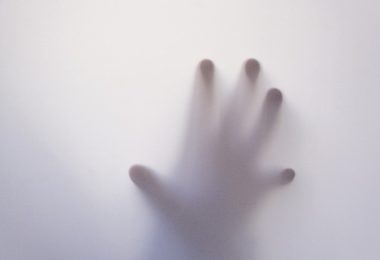 hand against glass -- mental health and anxiety
