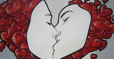 graffiti art sharing a kiss