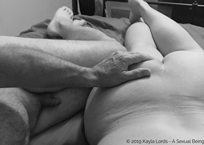 black and white image of naked John Brownstone rubbing Kayla Lords' butt