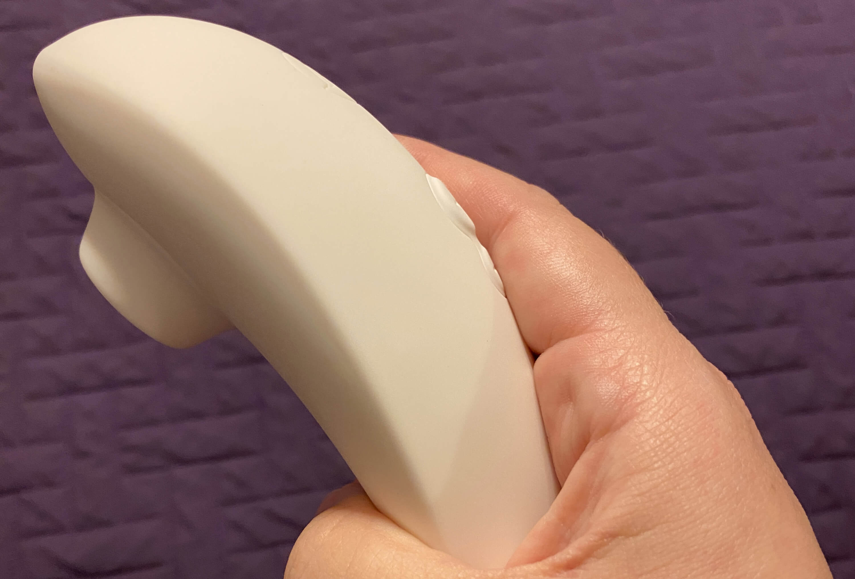 Kayla holding Womanizer Premium in side or profile view