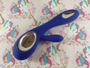 blue LELO Soraya Wave vibrator on unicorn background